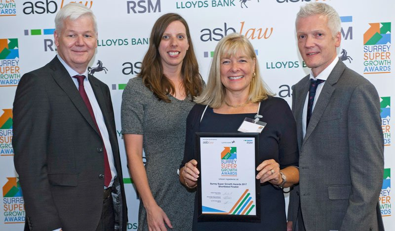 Nikki and Graeme accepting our Surrey Super Growth award